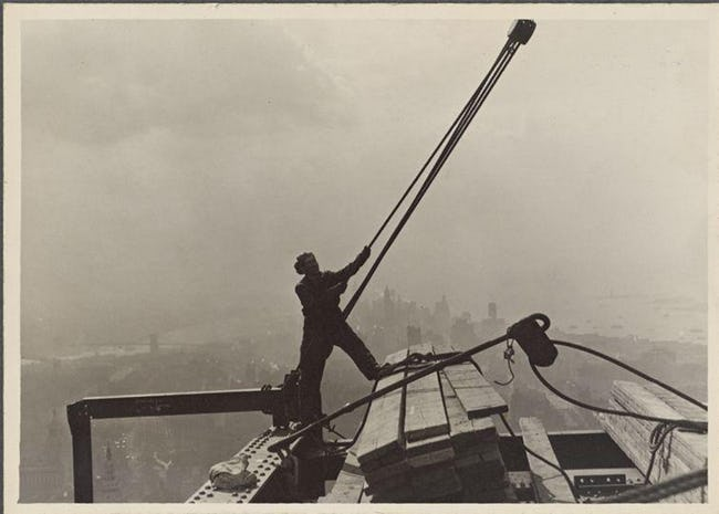 Construction Worker Maneuvering Rope And Pulley Empire State Building Workers Photo