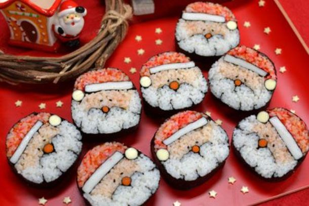 decorative cucumber slices Santa sushi for Christmas.
