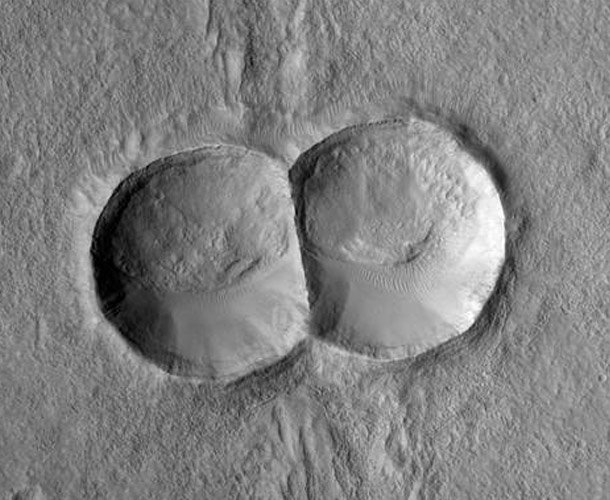 Mitosis crater in Mars Strangest Things in Space
